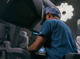 Surgeon looking through Robotic Surgery equipment